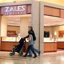 Two people were arrested on suspicion of felony theft after police said one of them swallowed a stolen ring from Zales in an attempt to hide it.