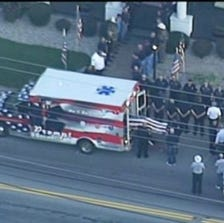 Tony Grider's body arrives at a Kentucky funeral home. The firefighter was fatally injured while taking part in an ice bucket challenge.