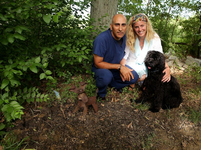 Dr. Nimu Surtani and his wife Laura with new puppy