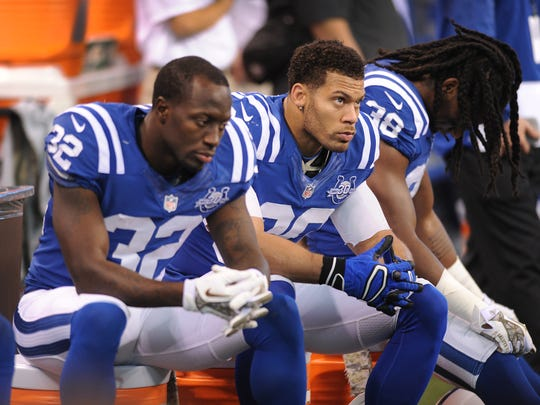 Dejected Indianapolis Colts cornerback Cassius Vaughn,left,  LaRon Landry,middle, and Sergio Brown,right. Indianapolis Colts play the St. Louis Rams Sunday, November 10, 2013, afternoon at Lucas Oil Stadium. Matt Kryger / The Star @mattkryger