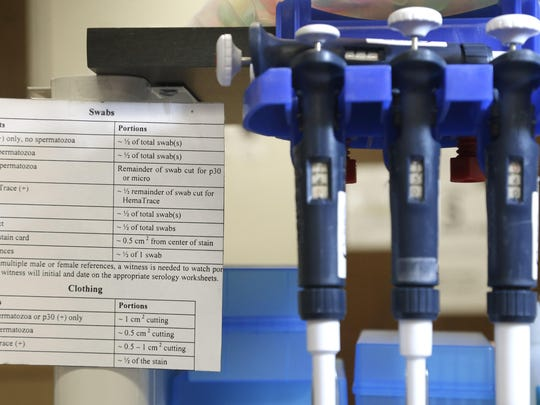 Instructions sit next to pipettes at a station in the biology lab at the Houston Forensic Science Center.