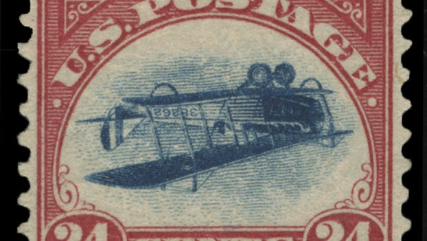 """This undated photo provided by Spink, USA, shows a 1918 """"inverted Jenny"""" stamp."""