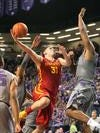 Georges Niang goes in for a shot