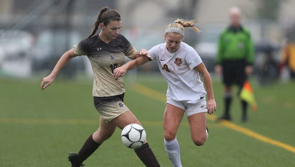 Arlington's (29) Amaliese Tucci (29) fends off Clarkstown