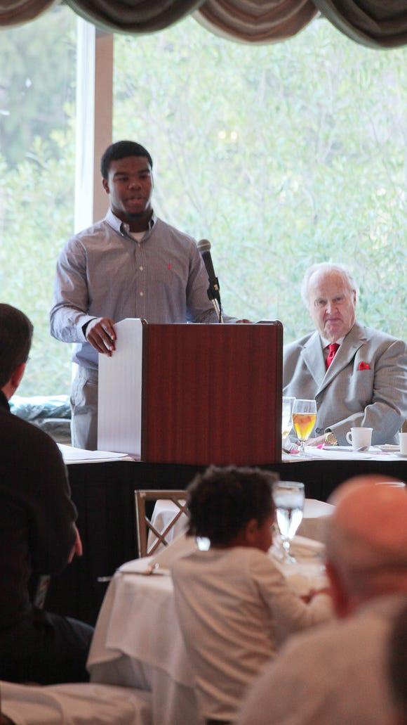 Damien Harris, award winner, speaks during the Paul Hornung Award presentation at Big Spring Country Club in Louisville, KY. Dec. 17, 2014