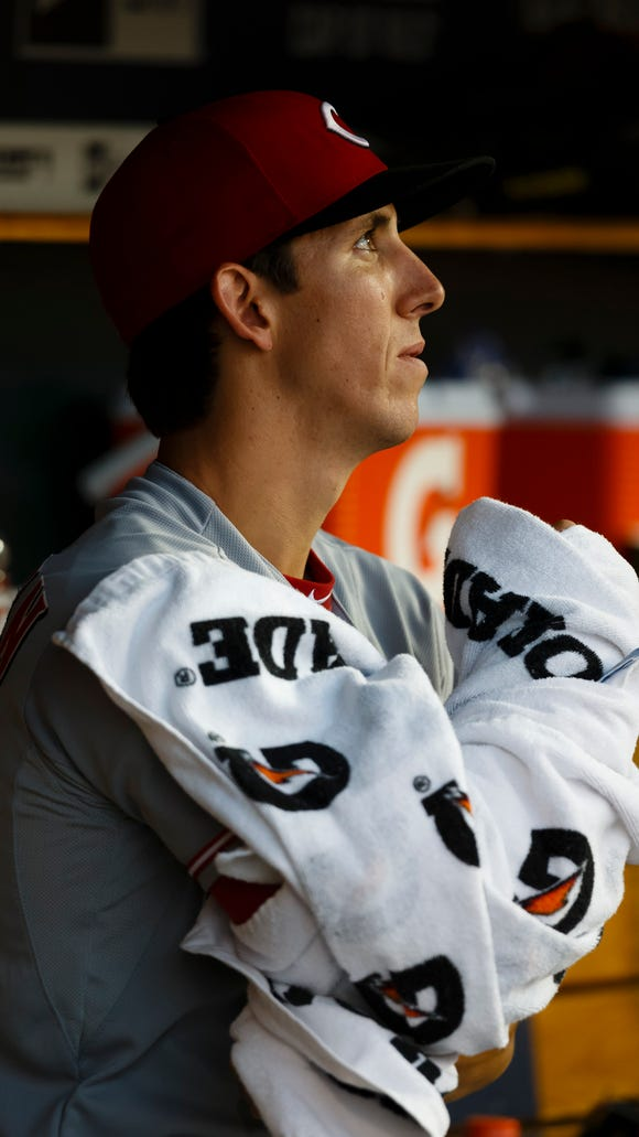 Cincinnati Reds starting pitcher Michael Lorenzen (50) sits in the dugout during the sixth inning.