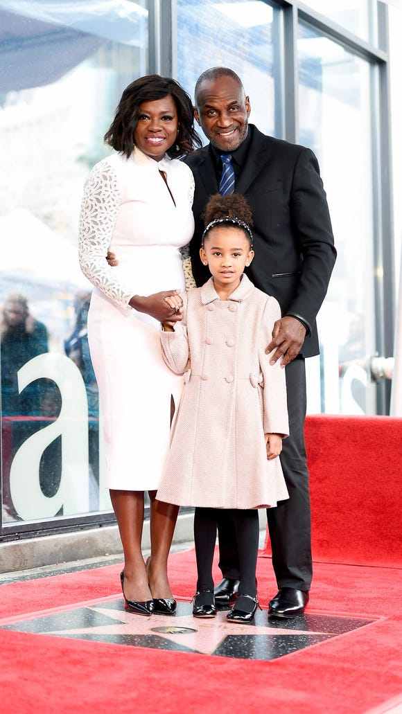 Davis with her husband, Julius Tennon, and her daughter,