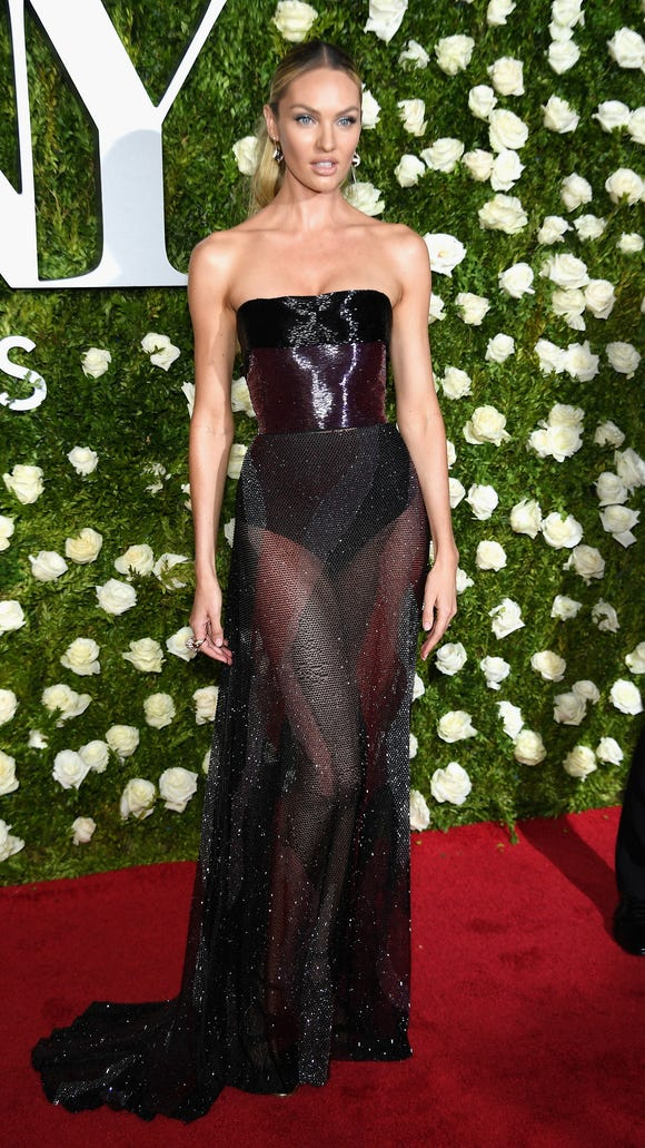 Candice Swanepoel showed off her legs in a sheer gown.