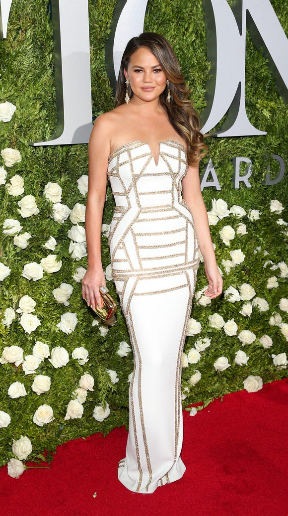 Chrissy Teigen in white and gold.