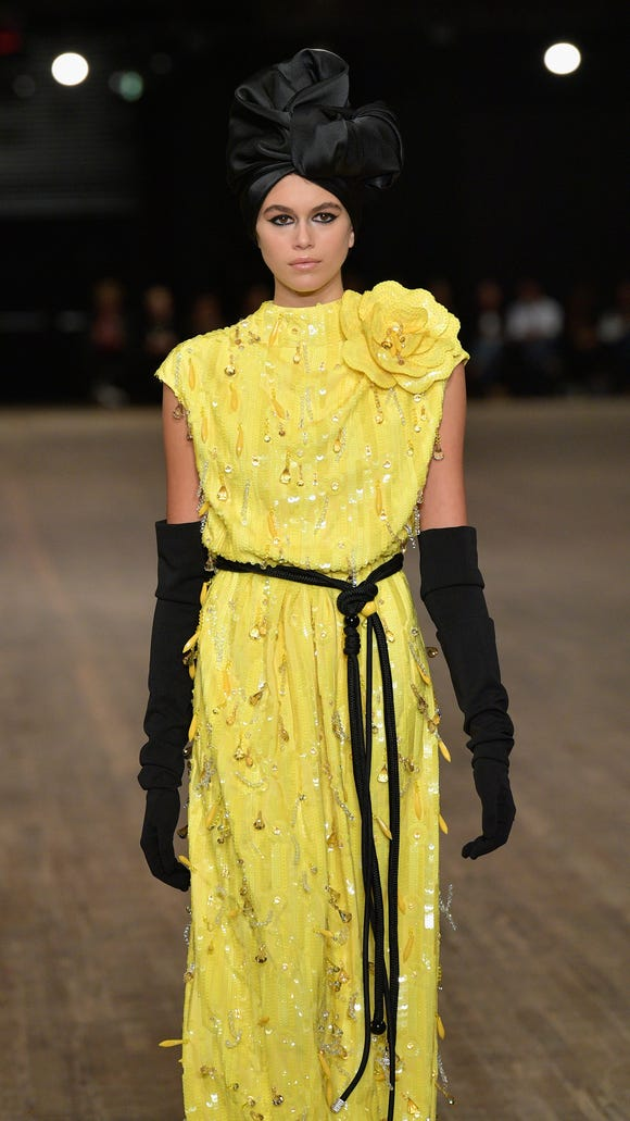 Kaia Gerber's canary-yellow look.