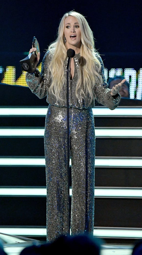 Carrie Underwood accepts an award onstage at the 2018 CMT Music Awards on June 6, 2018 in Nashville.