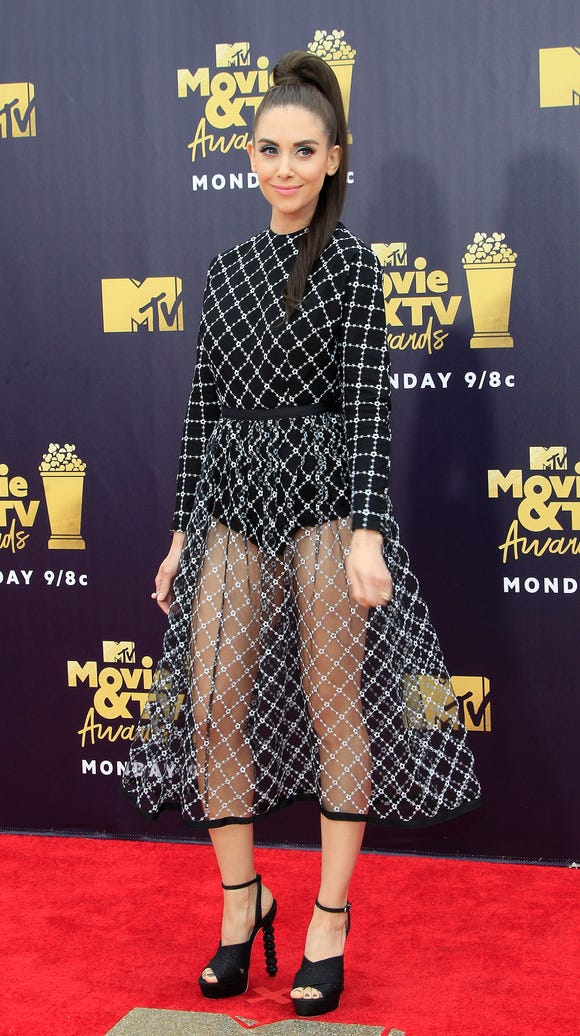 """GLOW"" star Alison Brie shined on the MTV carpet."