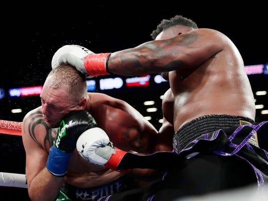 APTOPIX_Miller_Duhaupas_Boxing_32853.jpg