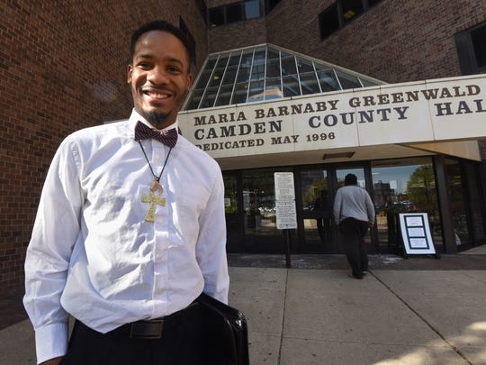 Quinzelle Bethea smiles outside the Camden County Hall of Justice on April 18 after a hearing in which he learned all charges filed against him related to a Nov. 22 arrest in Camden had been dropped.