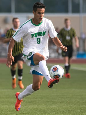 York College forward Joel Teston, controls the ball during the first half of a non-conference soccer match against Randolph Thursday, Sept. 1, 2016, at York College. Amanda J. Cain photo
