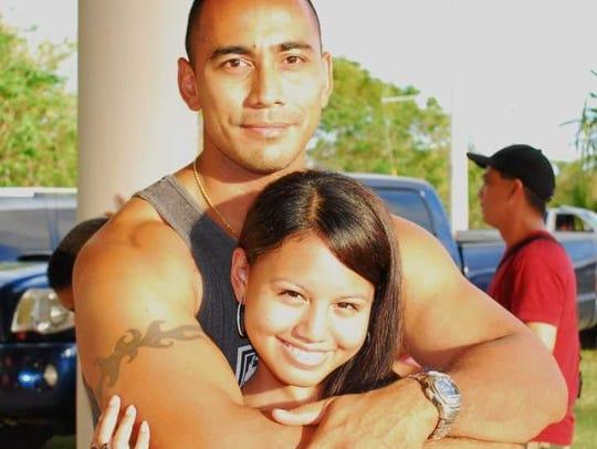 Eric Castro hugs his daughter Jacquelyn Certeza.
