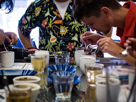 Workshop participants learn to experience coffee in its various forms during a cupping workshop May 23 at Guam Coffee Company.