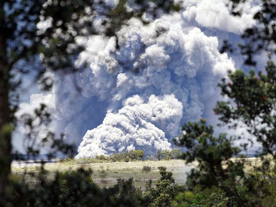A column of ash from the  Kilauea volcano towers over
