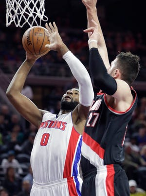 Pistons center Andre Drummond is defended by Trail Blazers center Jusuf Nurkic on Feb. 28, 2017 at The Palace.