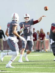 Massachusetts quarterback Andrew Ford launches throws