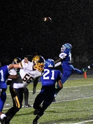 Gianni Gamble (30) of Winton Woods blocks a Moeller