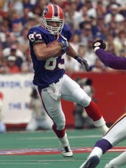 Buffalo's Andre Reed heads up field after a reception against the Vikings on Aug. 31, 1997.