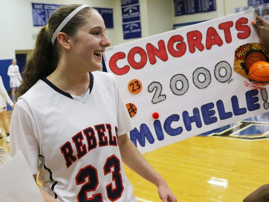Michelle Sidor of Saddle River Day celebrates her 2,000th career point in a Bergen County Tournament win over Holy Angels on Saturday, Jan. 27, 2018.