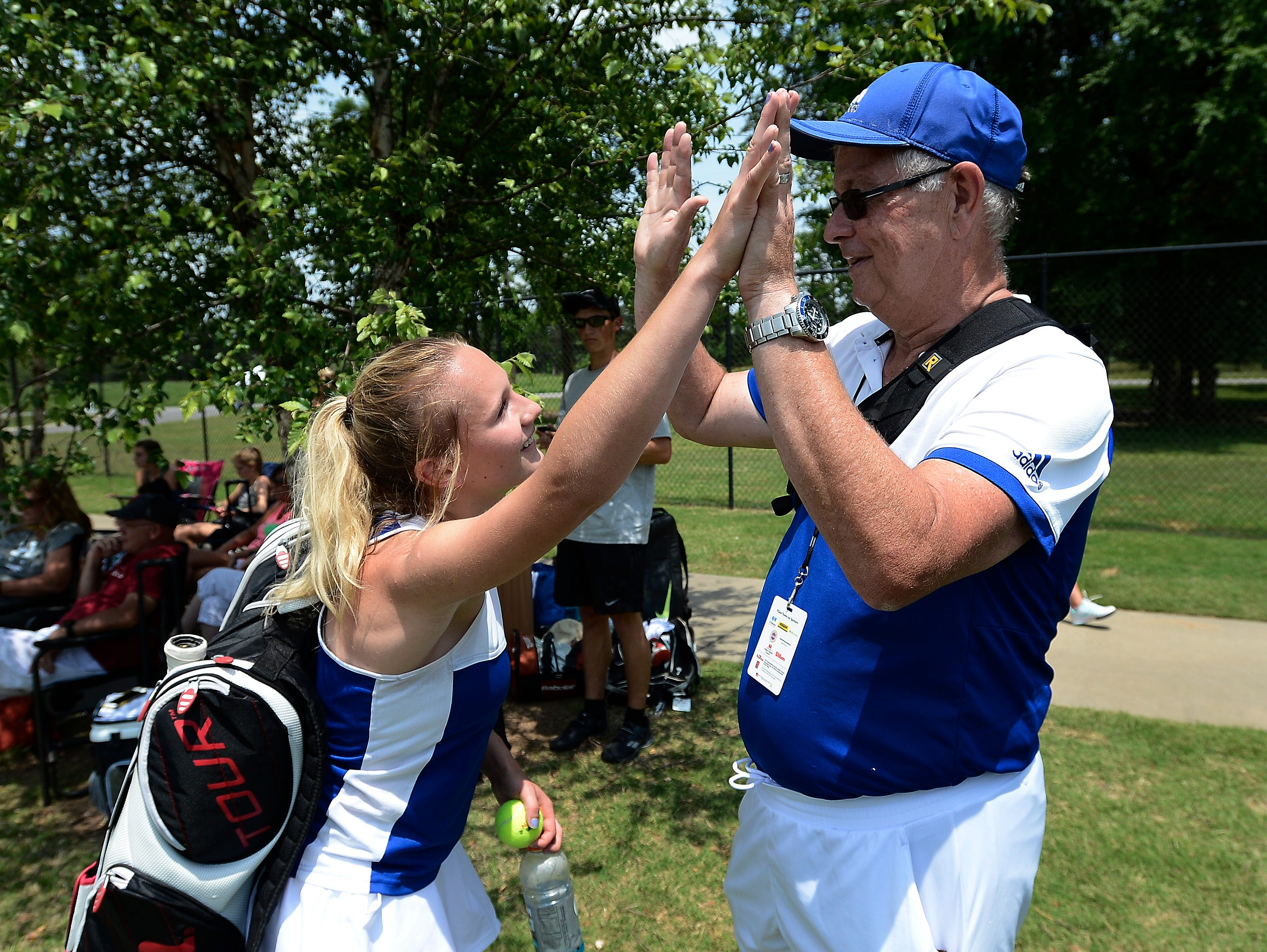 Brentwood High School player Nikki Christiansen celebrates with head coach Bill Jayne after she won her match against Houston High School during the Tennessee Class AAA girls team tennis championship final Wednesday, May 25, 2016, in Murfreesboro, Tenn.