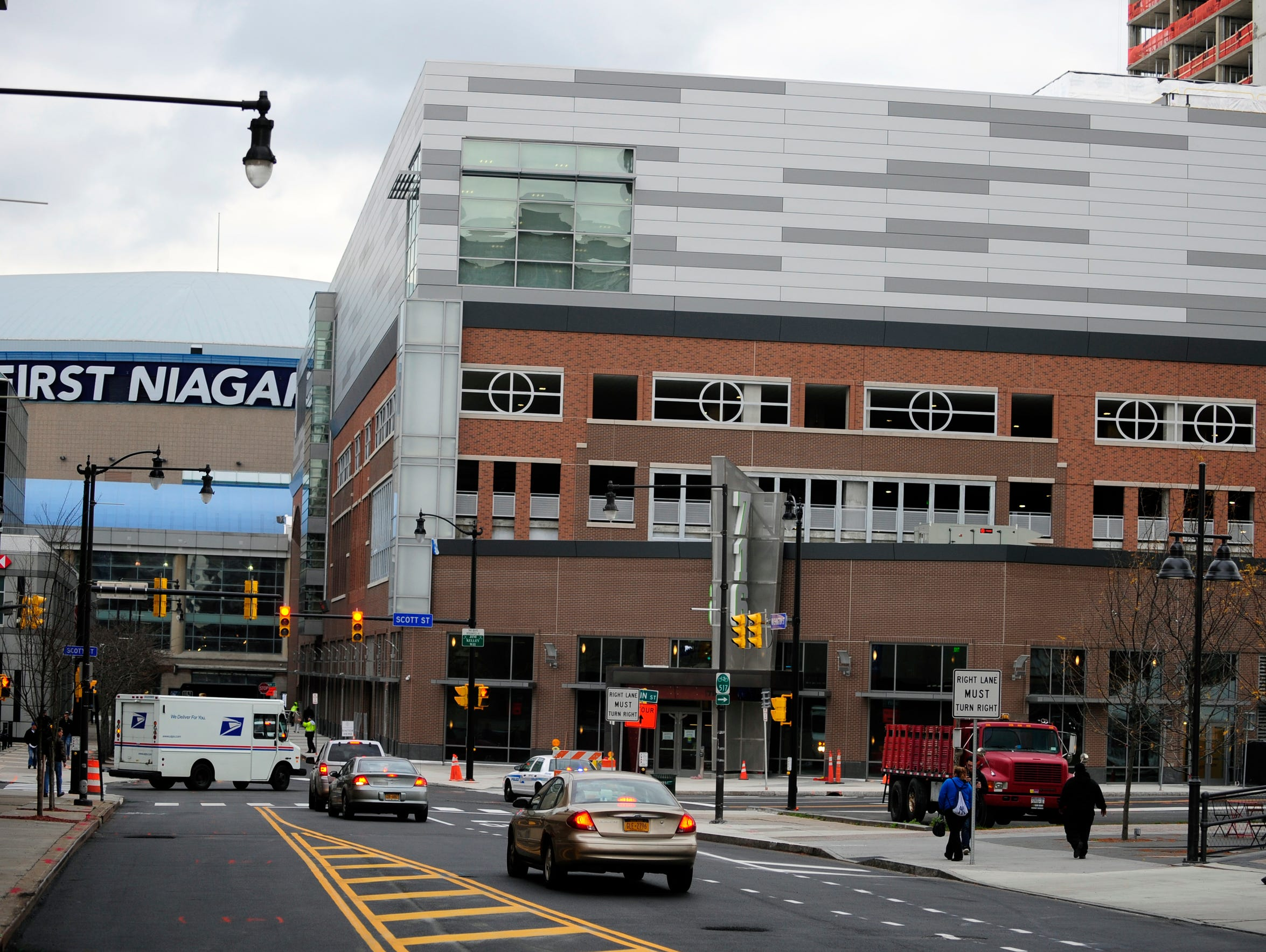 Traffic starts to flow in front of HarborCenter, which