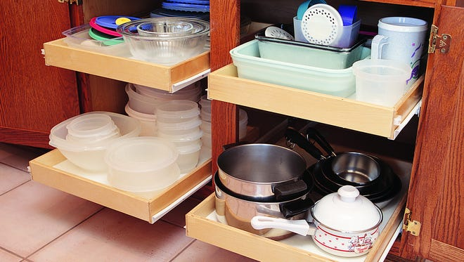 Roll-out shelves make organizing easy because they take away the need to reach deep inside cabinets while standing or kneeling at awkward angles that don't allow you to see the entire space well.