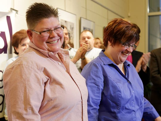Jayne Rowse, left, and her partner April DeBoer smile