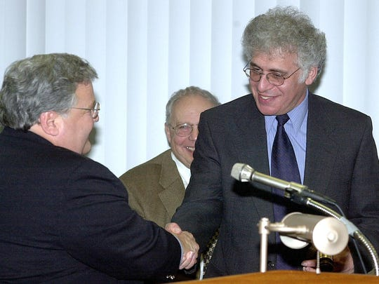 Ilan Schoenberger, right. is congratulated by Rockland County Democratic Chairman Vincent Monte after being sworn in as chairman of the Rockland County Legislature in a 2001 photo