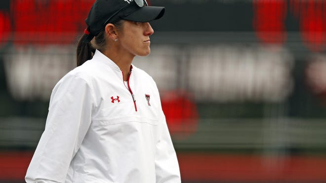 """Texas Tech coach Adrian Gregory watches her players during a Big 12 Conference game in 2018. Gregory announced in statement, """"At this time, I have found it best to part ways with Texas Tech University and its softball program."""""""