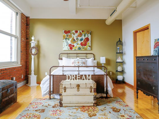 Laura Callens moved from a 170-year-old farmhouse into a loft apartment in the Temple Building.