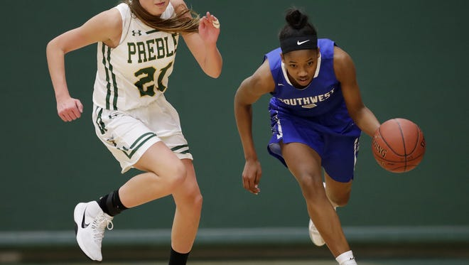 Green Bay Southwest's Jaddan Simmons, right, dribbles past Green Bay Preble's Carley Duffney in an FRCC girls basketball game Tuesday at Preble High School in Green Bay.