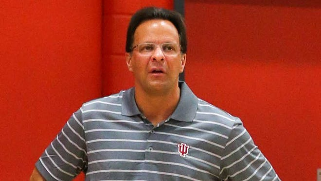IU coach Tom Crean (pictured) could yet add a 13th scholarship player ahead of this coming season. Emmitt Holt, a forward from New York, is visiting Bloomington this week.