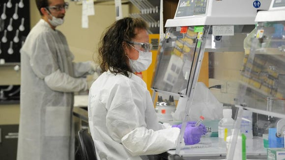 Jennie McMahon is a Supervisory DNA Analyst with the Armed Forces DNA Identification Laboratory at Dover Air Force Base. The Pentagon has ordered the exhumation of 388 unidentified sailors who died at Pearl Harbor aboard the battleship Oklahoma, and the lab will analyze DNA samples from the remains to help identify them.