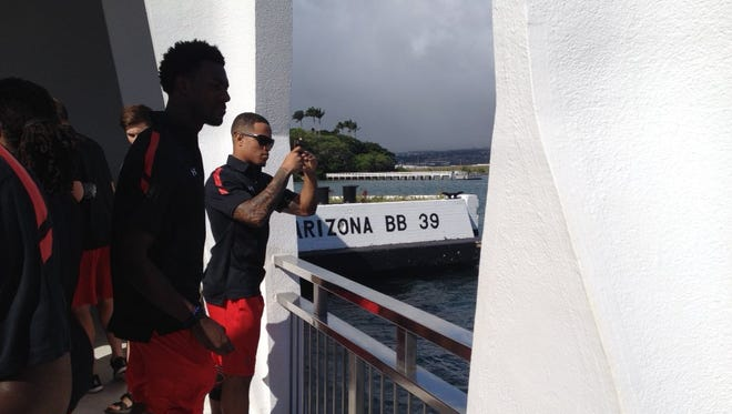 Shaq Washington (taking picture) and his UC teammates visited the USS Arizona Memorial at Pearl Harbor on Tuesday.