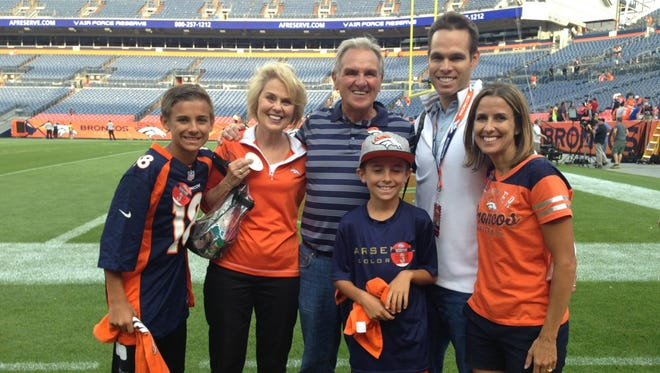 Former CSU coach Sonny Lubick and his wife, Carol Jo, are pictured before a Denver Broncos game earlier this season with their son, Marc, a Broncos assistant coach, daughter Michelle Lubick-Boyle and her two oldest boys, Matt, and Will.