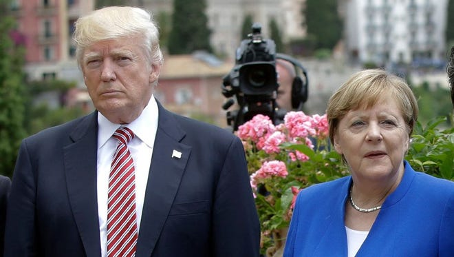 President Trump flanked by German Chancellor Angela Merkel during the G7 meeting in Taormina, Italy, on May 26.