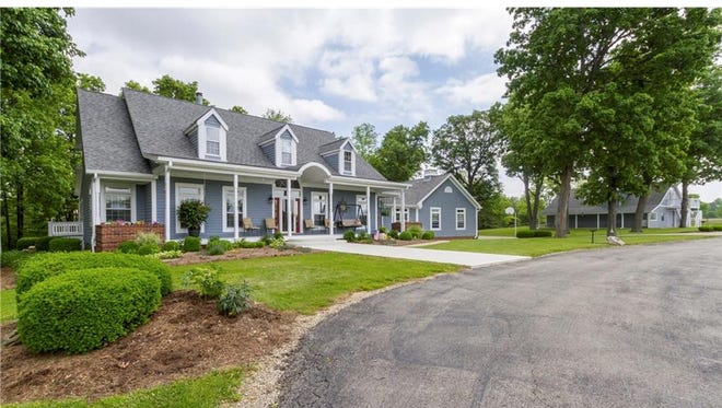 This Yorktown home includes eight acres of rolling hills, trees and a one-acre pond. Inside, there are four bedrooms, two full bathrooms and two half bathrooms amid 5,000 square feet of living space. It's listed at $649,000.