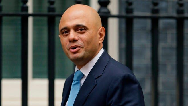 In this file photo dated Tuesday, Oct. 10, 2017, Sajid Javid arrives for a meeting at 10 Downing Street in London.