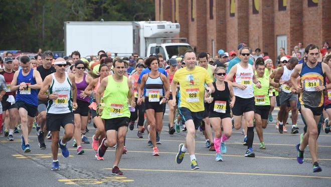 Runners begin the half-marathon race of the 2016 Dutchess County Classic at Arlington High School in Freedom Plains on Sunday.