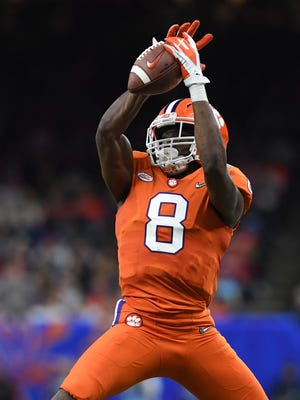 Clemson wide receiver Deon Cain (8) catches a pass against Alabama during the 4th quarter of the Allstate Sugar Bowl at the Mercedes-Benz Superdome in New Orleans on Monday, January 1, 2018.