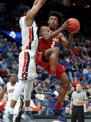 Collin Sexton, right, led Alabama past Auburn in the SEC Tournament in St. Louis.