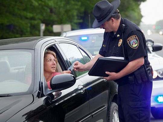 Policeman giving driver speeding ticket