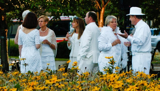 Guests mingle among the flowers in Lytle Park at Diner en Blanc in 2012.