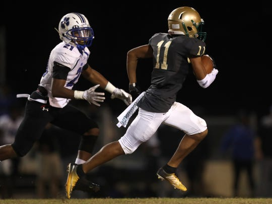 Lincoln's Marko Skarica sprints downfield with Godby's Justin King in persuit during their game at Cox Stadium on Friday.