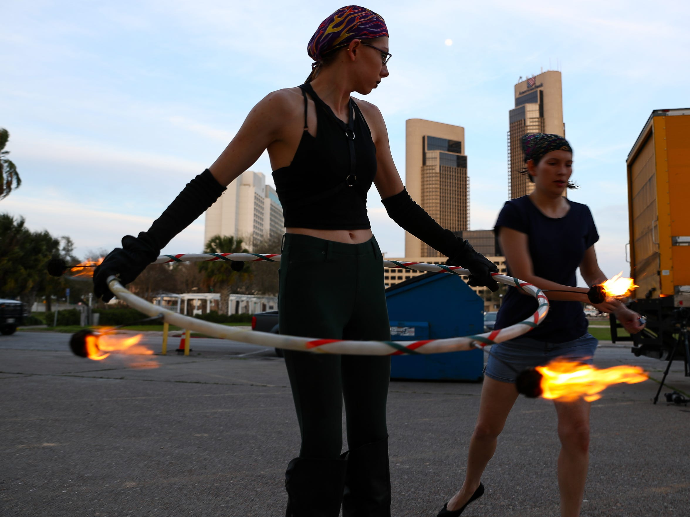 Viktoria Birr demonstrates fire spinning using a hula hoop outside the Corpus Christi Caller-Times building on Tuesday, Feb. 27,2018.