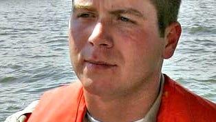 Matt Bruner, Iowa Department of Natural Resources law enforcement officer, warns against travel on waterways swollen by recent heavy rains.